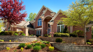 brick house with new landscaping features